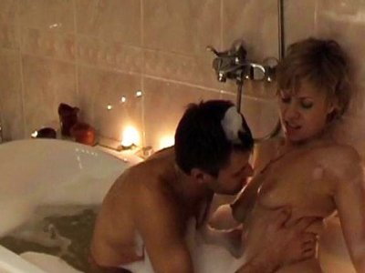 Couples sex in foamy bath