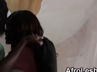 African dykes Megan and Veronica are having hot lesbian sex in bedroom