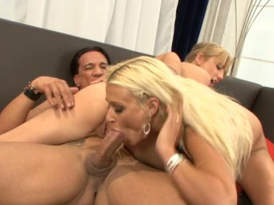 Two sexy blondies get fucked on a leather couch