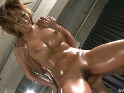 Steamy Asian bitch Maeda Hina is oiled all over the body and got her wet pussy fingered