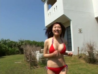Tempting Japanese wench Mai First is posing wearing seductive bikinis