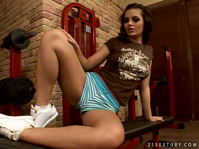 Curly brunette with heavy makeup Eve Angel rubs her wet pussy