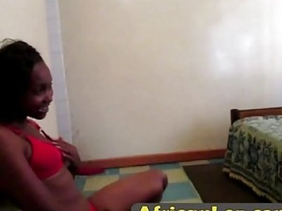 Bedroom lesbian action with two busty African sluts