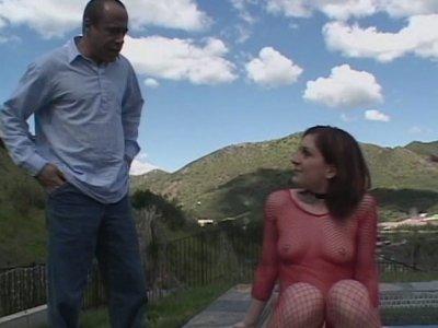 Curvy brunette Renee Pornero in red fishnet outfit masturbating