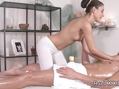 Cute masseuse giving footjob in massage room