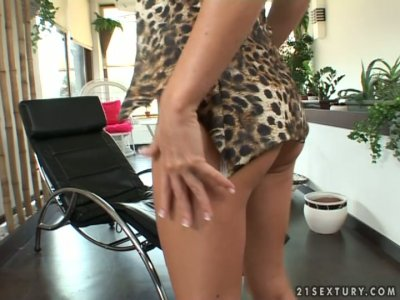 Awesome European blonde Dorina Gold stripteases and opens her legs